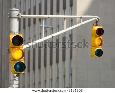 A traffic light turns yellow at an intersection in indianapolis