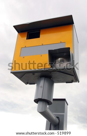 A traffic speed enforcement camera facing left.
