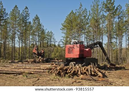 A trailer mounted log loader.