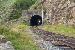 a train comes out the tunnel