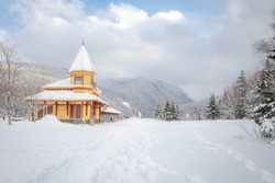 A train depot covered in snow in the valley of Crawford Notch, NH