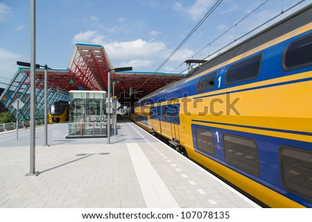 A train is leaving the central station of Lelystad, the Netherlands