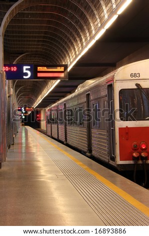 A train parked in an underground train station ready to depart