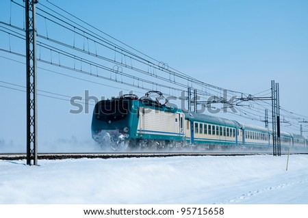 a train passes on a cold winter landscape