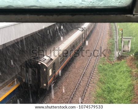 A train was stopping by a station during a heavy rainy day. Stok fotoğraf ©