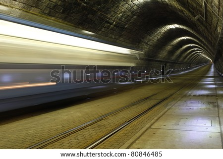 A tram disappearing into a tunnel