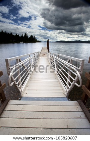 A tranquil image of a dock by Coeur d'Alene Lake in north Idaho. - stock photo