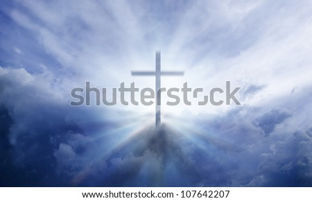 A transparent Cross giving out heavenly light in the sky.