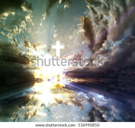 A transparent Cross giving out heavenly light in the sky