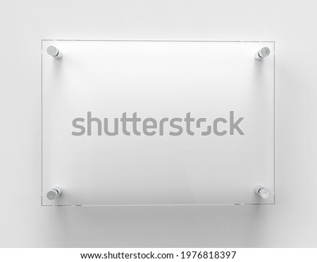 A4 Transparent glass nameplate plate on spacer metal holders. Clear printing board for branding. Acrilic advertising signboard on white background mock-up. Size 297 x 210 mm. 3D illustration Stockfoto ©