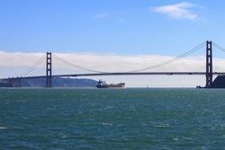 A transport ship crossing the famous Golden Gate Bridge, San Francisco, California, USA -
