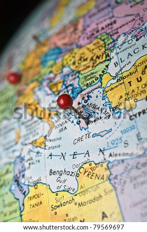 A travel or in-the-news concept, map of the world with a pin marking the area of Athens Greece.