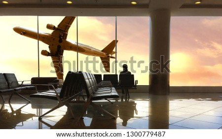 a Traveler waiting for flight at the airport #1300779487