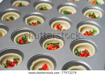 A tray of delicious Mexican appetizers about to go in the oven