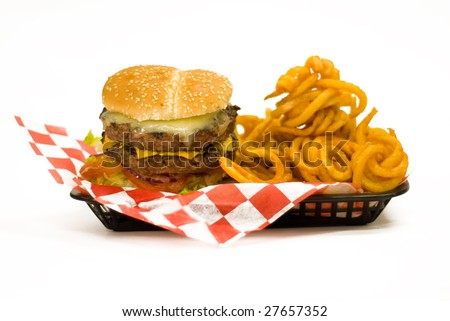 A tray with a Juicy Burger and with curly fries.