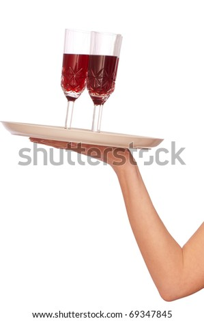 A tray with three glasses of champagne