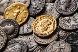 A treasure of Roman gold and silver coins.Trajan Decius. AD 249-251. AV Aureus.Ancient coin of the Roman Empire.Authentic  silver denarius, antoninianus,aureus of ancient Rome.Antikvariat.