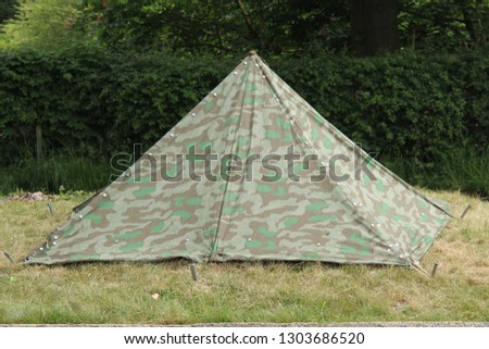 A Triangular Shaped Vintage Military Canvas Tent. #1303686520