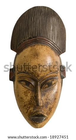 A tribal mask from West Africa, silhouetted on white with clipping path.