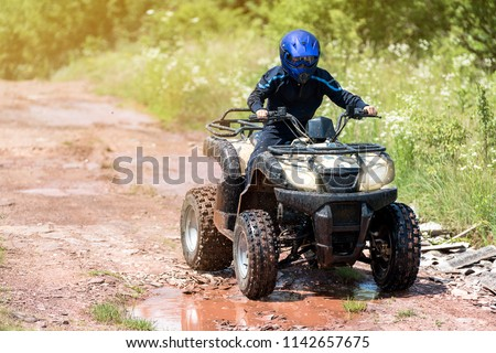 A trip on the ATV on the red road. Stock photo ©
