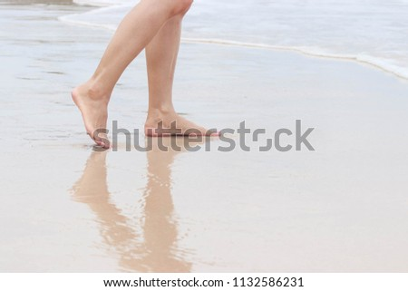 A trip on the beach-young walking on the sand and happy holiday. #1132586231