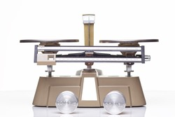 A triple beam balance used to measure the mass of materials.