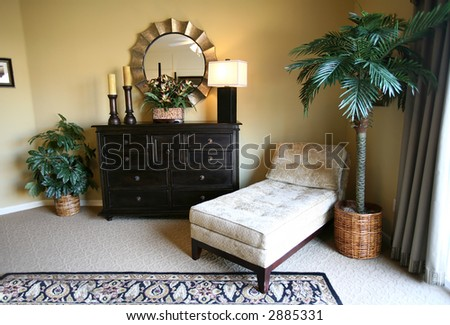 A tropical themed lounge inside an upscale home