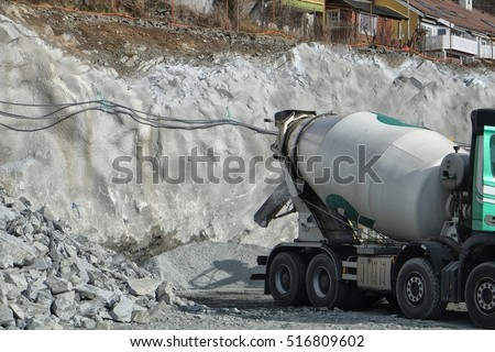 stock-photo-a-truck-offloading-cement-on