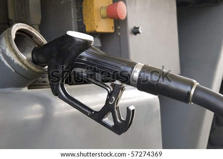 a truck refueling at a gas station before you travel