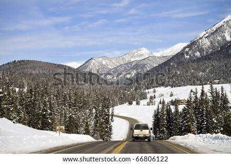 A Truck Traveling on a Highway in Montana in Winter