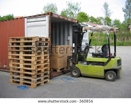 A truck unloading pallet from container