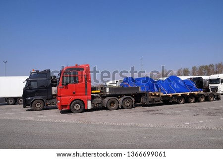 A truck with a special semi-trailer for transporting oversized loads. Oversize load, long load or convoi exceptionnel. #1366699061
