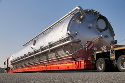 A truck with a special semi-trailer for transporting oversized loads. Oversize load or exceptional convoy.