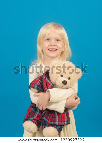 A true friend. Little child with soft toy. Little girl with teddy bear. Small girl hold toy bear. Small kid happy smiling. Happy childhood. My favorite childhood toy.