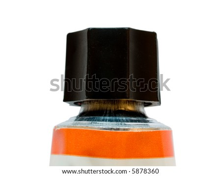 A tube of orange oil paint isolated on a white background