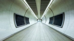 A tunnel used by passengers to get to their next destination or form of travel to get onward travel.