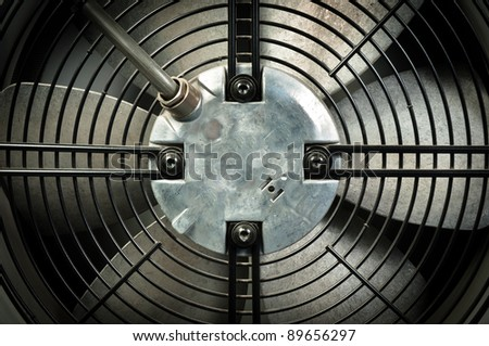 A turbine behind black bars