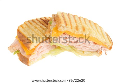 A turkey panini with cheddar cheese on a white background