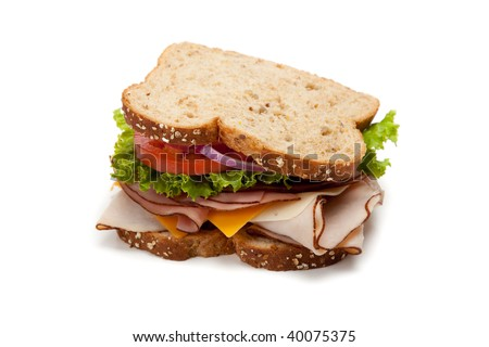 A turkey sandwich on multigrain bread with lettuce, tomato, Cheese and onions on a white background