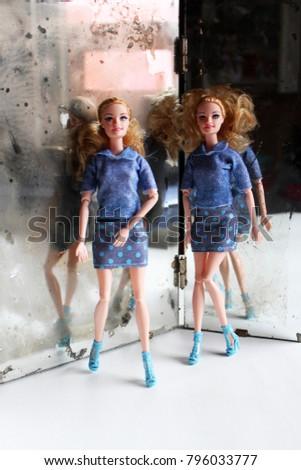 A twin dolls beside the mirror