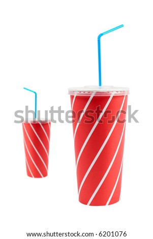 A two soda drinks with blue straw, isolated on white background. Focus at front