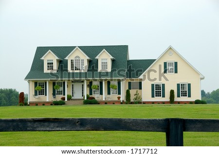 A two story vinyl sided farmhouse sits on the manicured for 2 story farmhouse