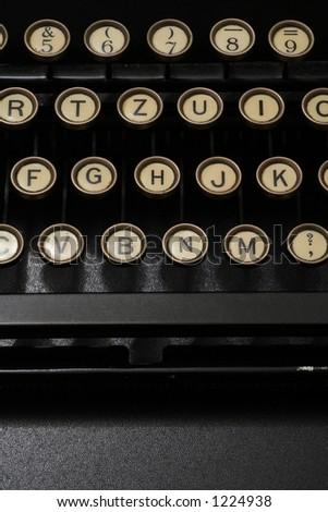 a typewriter in dramatic lighting