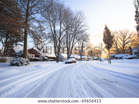 A typical American street as the sunrises after a winter storm