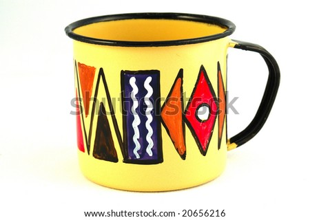 A typical colorful African tin coffee cup isolated on white background - stock photo