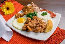 A typical dish of Brazilian cuisine called virado a paulista. Viewed from above on a decorated table.