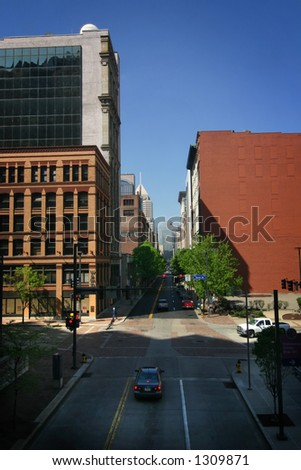 a typical downtown street scene with slanting sun, taken in pittsburgh, PA.
