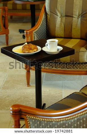A typical french table breakfast into an hotel with croissants and coffee at Paris