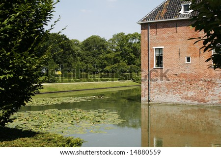 A typical northern netherlands mansion from the 14th century with a moat and beautiful gardens