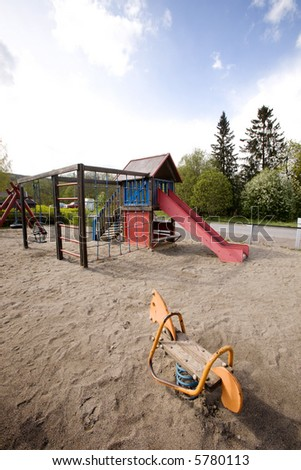 A typical playground with sand on the ground - stock photo